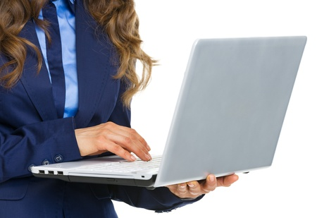 Closeup on business woman working on laptop Stock Photo - 21250433