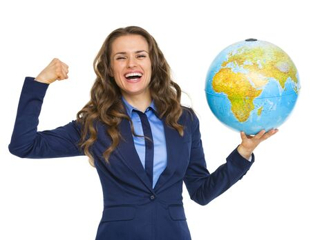 Happy business woman showing earth globe and biceps photo