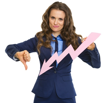 Frustrated business woman showing graph arrow going down and thumbs down photo