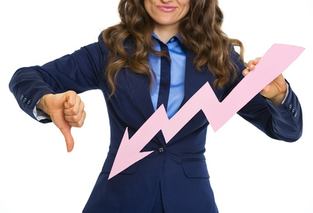 Closeup on business woman showing graph arrow going down and thumbs down photo