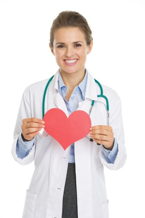 Smiling doctor woman holding heart shape paper Stock Photo - 21250577