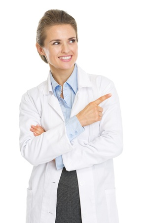 Smiling doctor woman pointing on copy space Stock Photo - 21250587