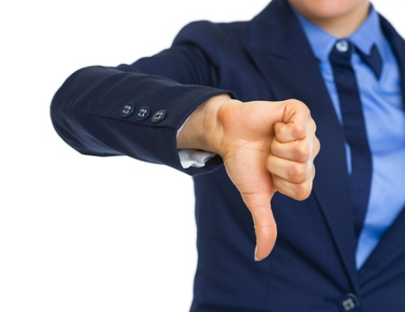 disapproval: Closeup on business woman showing thumbs down