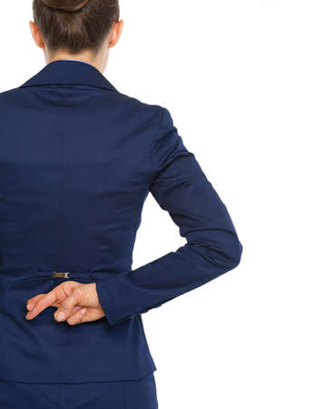 double game: Business woman holding crossed fingers behind back . rear view Stock Photo