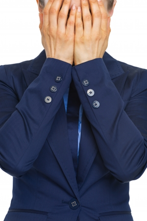 Closeup on stressed business woman closing face with hands Stock Photo - 21336044