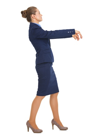 Full length portrait of business woman walking like zombie Stock Photo