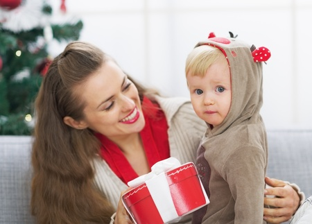 Happy mother and baby spending christmas time together Stock Photo - 21353194