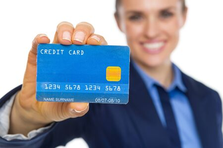Closeup on smiling business woman showing credit card Stock Photo - 21353308