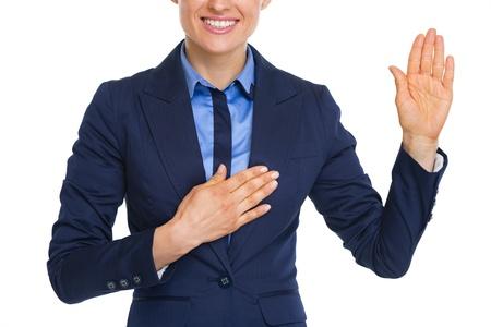 oath: Closeup on happy business woman oath truth Stock Photo