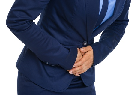 Closeup on business woman having stomach pain photo