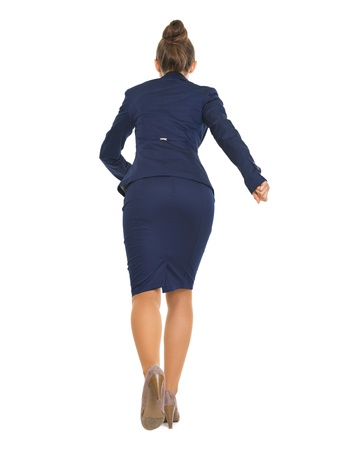 back straight: Full length portrait of business woman running straight . rear view Stock Photo