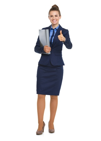 Full length portrait of happy business woman with folder showing thumbs up photo