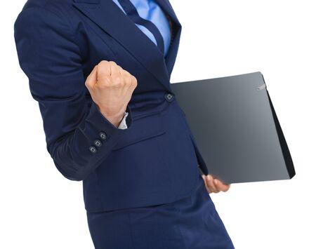 rejoicing: Closeup on business woman with folder rejoicing success
