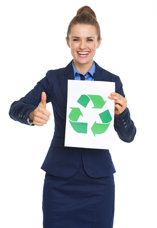 Happy business woman showing recycle sign and thumbs up photo