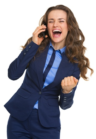 rejoicing: Happy business woman talking cell phone and rejoicing Stock Photo
