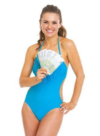Smiling young woman in swimsuit showing fan of euros Stock Photo - 21353829