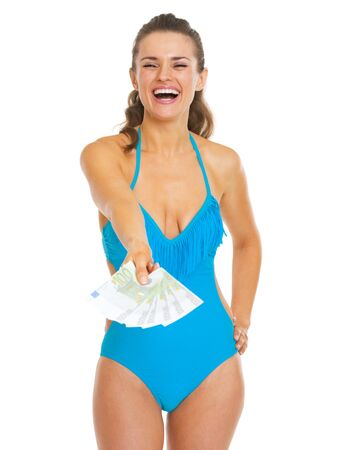 Smiling young woman in swimsuit giving fan of euros Stock Photo - 21353833