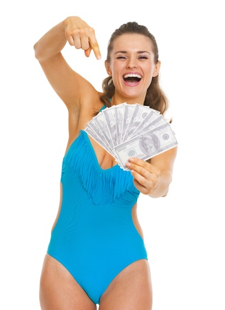 Smiling young woman in swimsuit pointing on fan of dollars Stock Photo - 21353852