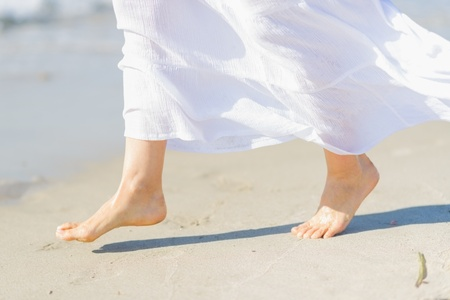 Closeup on leg of young woman on sea coast Stock Photo - 21338337