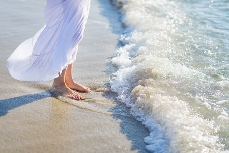 Closeup on leg of young woman standing on sea shore Stock Photo - 21338340