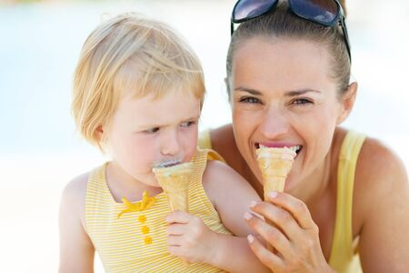 Mother and baby biting ice cream photo