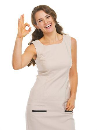 Smiling young woman showing ok gesture Stock Photo - 21355020