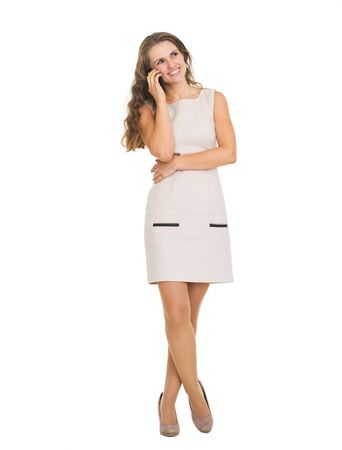 Full length portrait of happy young woman talking cell phone Stock Photo - 21359589