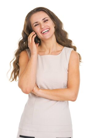 Portrait of smiling young woman talking mobile phone Stock Photo - 21359596