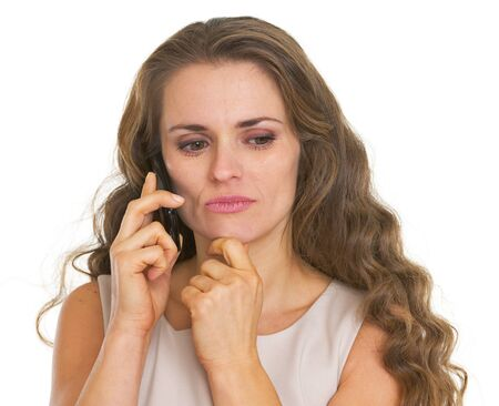 disquieted: Concerned young woman talking cell phone