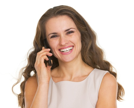 Smiling young woman talking mobile phone Stock Photo - 21359619