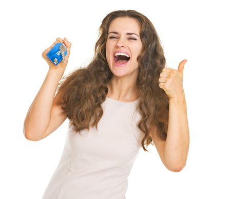 Happy young woman showing keys and thumbs up Stock Photo - 21359620