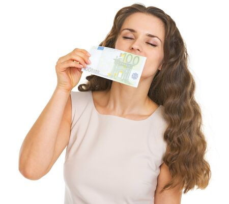 Young woman sniffing 100 euros banknote Stock Photo - 21359628