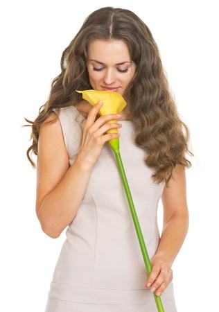Young woman enjoying kala flower Stock Photo - 21359635