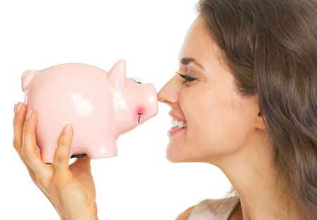 Happy young woman holding piggy bank Stock Photo - 21359658
