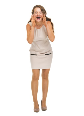 Full length portrait of smiling young woman shouting through megaphone shaped hands Stock Photo - 21359712