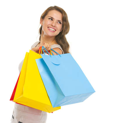 Portrait of happy young woman with shopping bags looking on copy space Stock Photo - 21359713