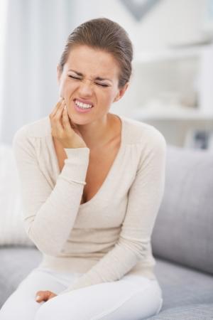 Young woman having toothache Zdjęcie Seryjne