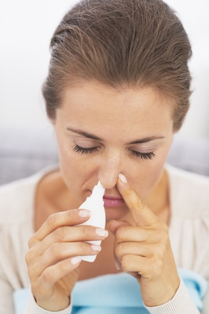 Woman using nasal drops Stock Photo - 21359746
