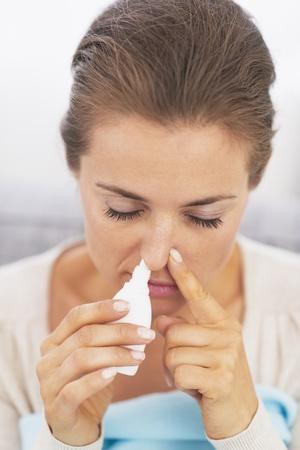 rheum: Woman using nasal drops Stock Photo
