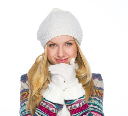 Portrait of smiling young woman in winter clothes warming hands Stock Photo - 21352261