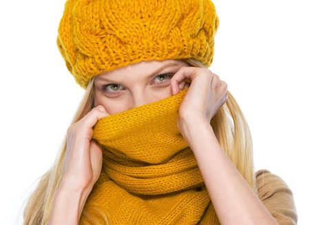 Young woman hiding in scarf Stock Photo - 21354881