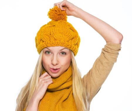 Happy girl holding took herself for hat Stock Photo - 21354882