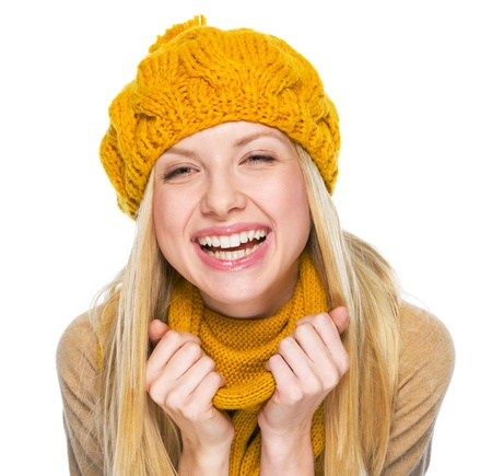 Portrait of happy young woman in hat and scarf Stock Photo - 21354889