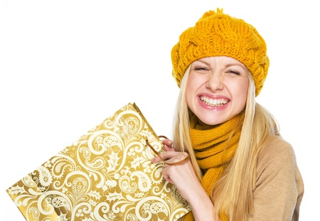 Happy young woman in hat and scarf with shopping bag Stock Photo - 21352269