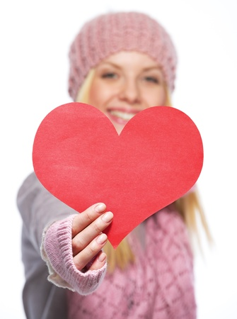 Closeup on heart shaped postcard in hand of teenager girl in winter gloves and scarf Stock Photo - 21354845