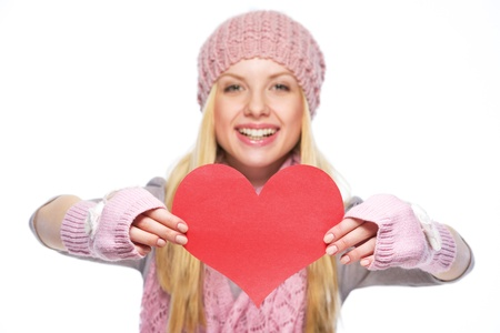 Closeup on heart shaped postcard in hand of teenager girl in winter hat and scarf photo