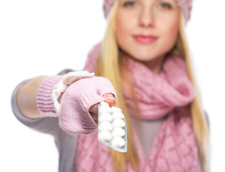Closeup on pills pack in hand of teenager girl in winter hat and scarf Stock Photo - 21354850
