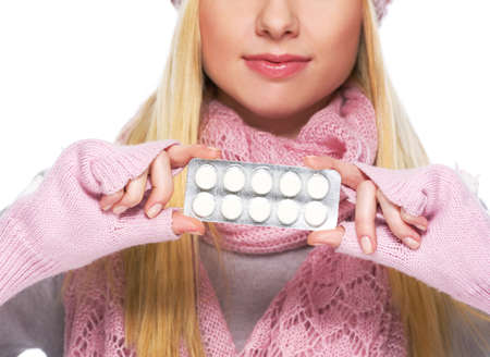 Closeup on pills pack in hand of teenager girl in winter gloves and scarf Stock Photo - 21354855