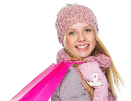 Portrait of happy teenager girl in winter hat and scarf with shopping bag Stock Photo - 21354821