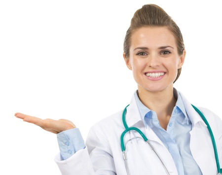 Smiling doctor woman presenting something on empty palm Stock Photo - 21567981